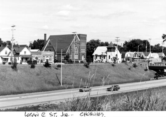 Churches on W. St. Joseph Street near S. Logan/MLK, circa 1972. Shown are (L to R) Mount Calvary Church, 1112 W. St. Joseph; Lansing Church of God in Christ, 1100 W. St. Joseph (NW corner with Logan); Galilee Baptist Church, 1026 W. St. Joseph. Interstate 496 had only been open for a short time when this was taken.