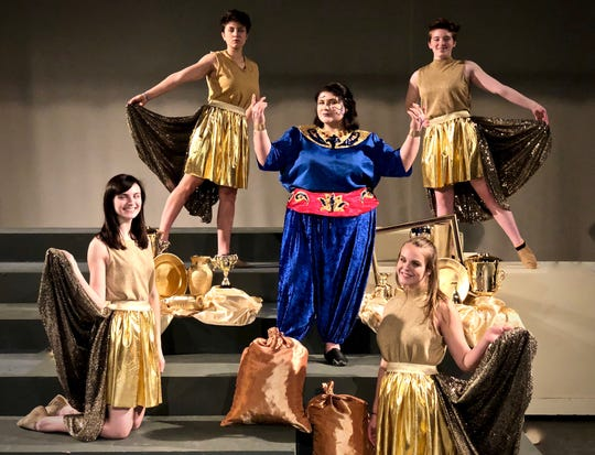 "Treehouse Theater's production of ""Disney's Aladdin JR."": Genie, played by Maya Pagel (center), is surrounded by magical gold dancers Jessica Iannitello and Morgan Wiesner (kneeling) plus Kaelle Hoeppner and Kiersten Moser (standing)."