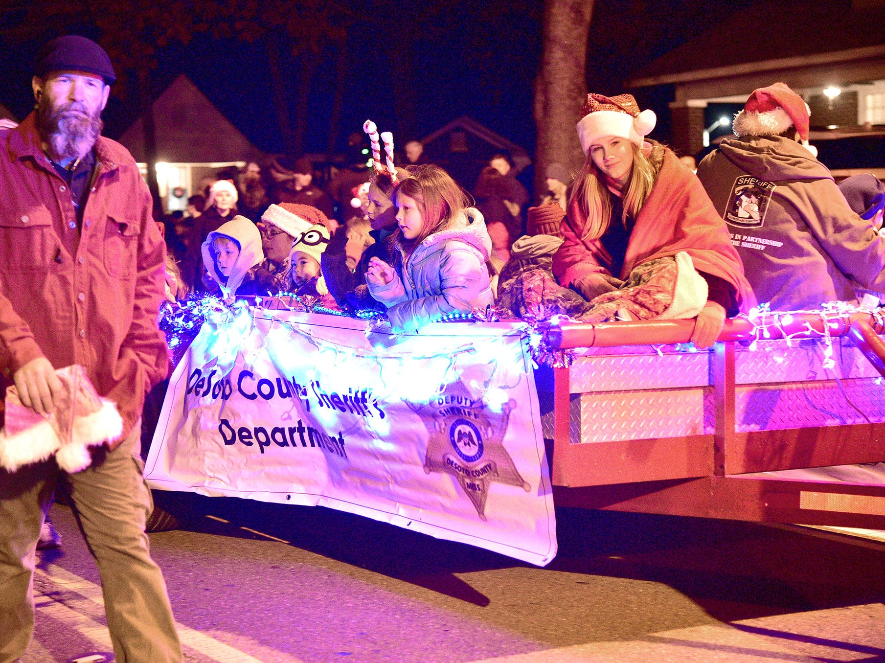 December 3, 2018 - Thousands gathered in Hernando on Monday evening to watch over 100 holiday decorated entries in the town's annual Christmas parade.