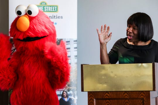 December 04 2018 - Sesame St. character Elmo and Dr. RenŽe Wilson-Simmons, executive director of ACE Awareness Foundation, are seen together during a press conference announcing Sesame Street in Communities partnership initiative to support early childhood development in Memphis and Shelby County at Porter-Leath Early Childhood Academy on Tuesday.