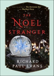 "On a freezing pre-Thanksgiving weekend, Maggie went to find a tree. And that's where the holidays turned for her in Richard Paul Evans' ""The Noel Stranger."""