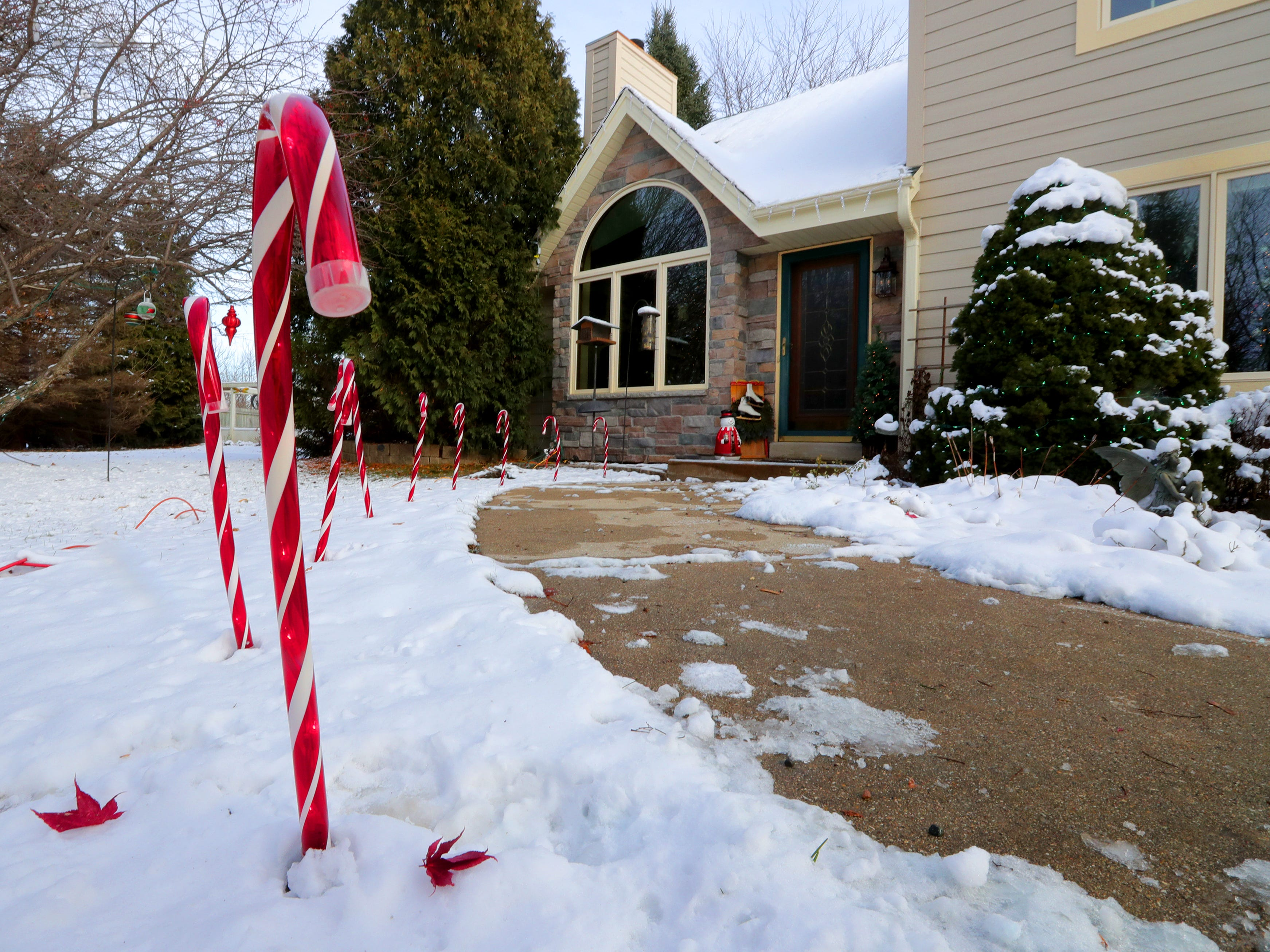 While Renee Sirny takes care of the decorations indoors, her husband, Lee, is in charge of the outdoor decorations, including these candy cane lights.