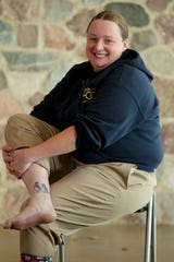 Heather Neldner, the aviary keeper, has a tattoo of penguins she got after becoming a penguin keeper at the zoo.