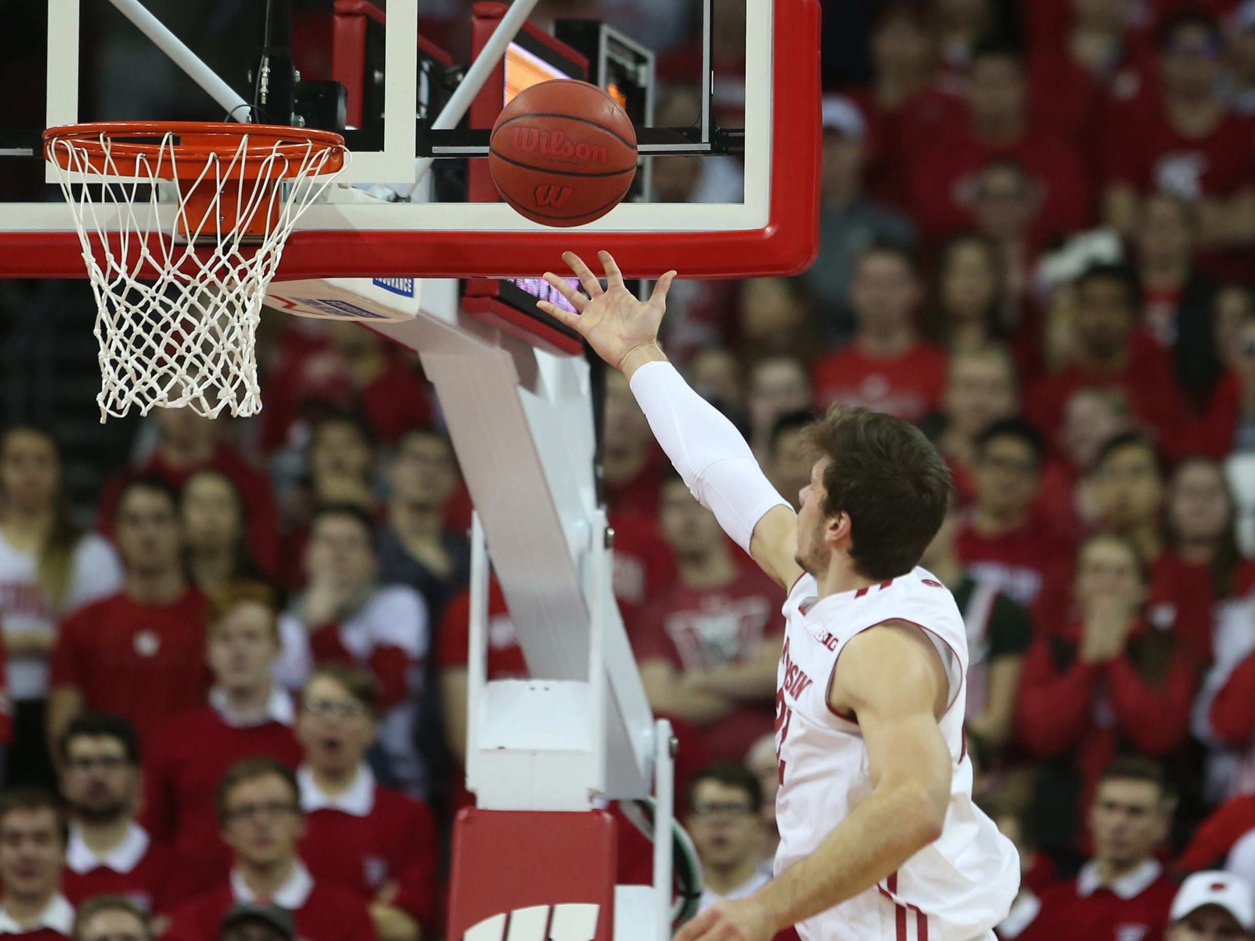 Wisconsin forward Ethan Happ has a clear path to the basket for an easy layup against Rutgers on Monday night.
