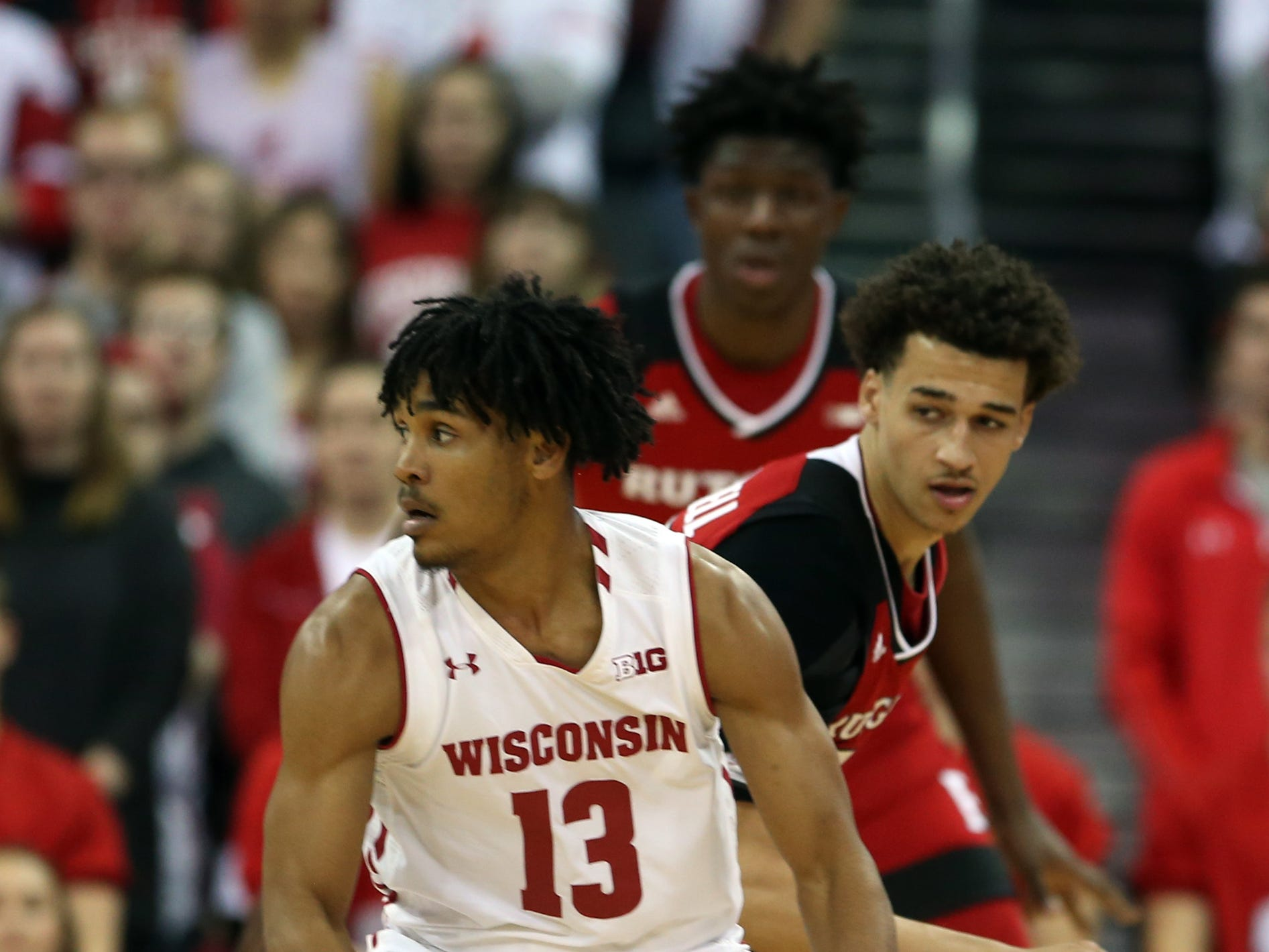 UW freshman guard Tai Strickland works the ball against Caleb McConnell of Rutgers during the first half Monday night.