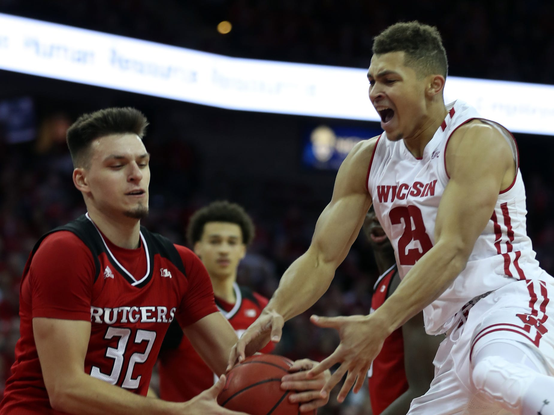Kobe King of the Badgers has the ball stripped away by Peter Kiss of Rutgers on Monday night.