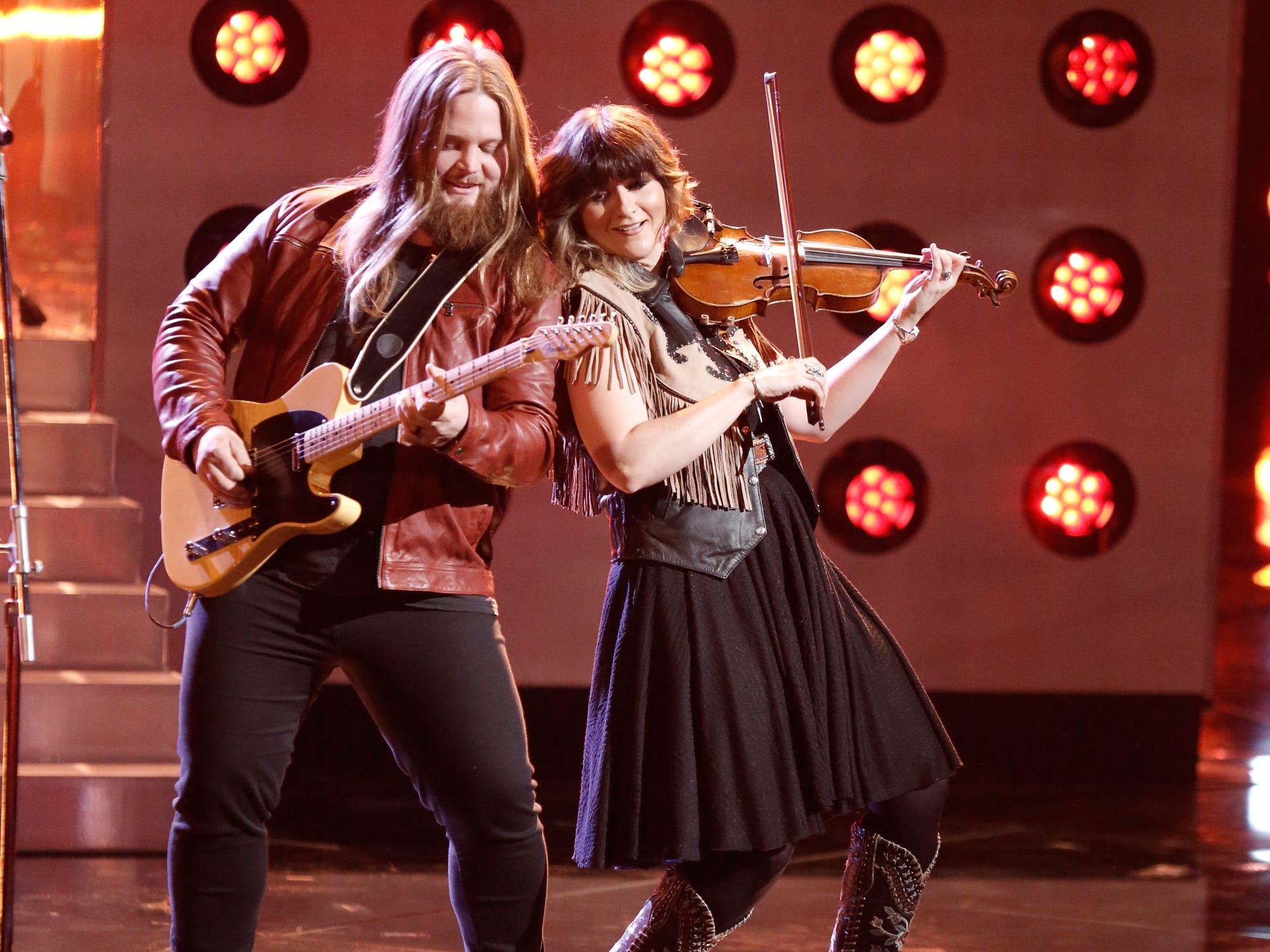 "Chris Kroeze performed a guitar and fiddle duet for the finale of his cover of Garth Brooks' ""Callin' Baton Rouge"" during the Dec. 3 episode of ""The Voice."""