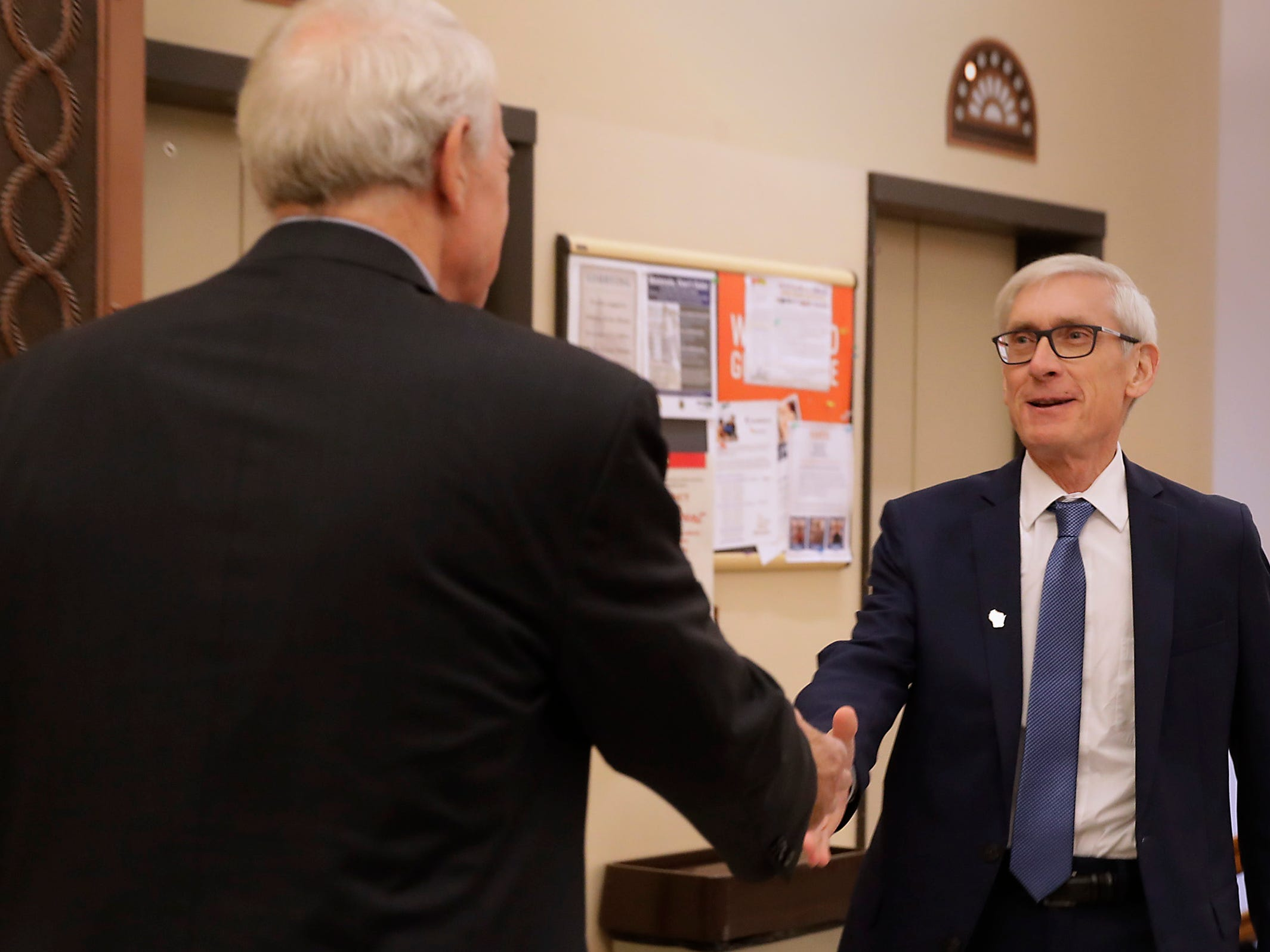 Mayor Tom Barrett (left) welcomes Gov.-elect Tony Evers to City Hall on Tuesday, Dec. 4, 2018.
