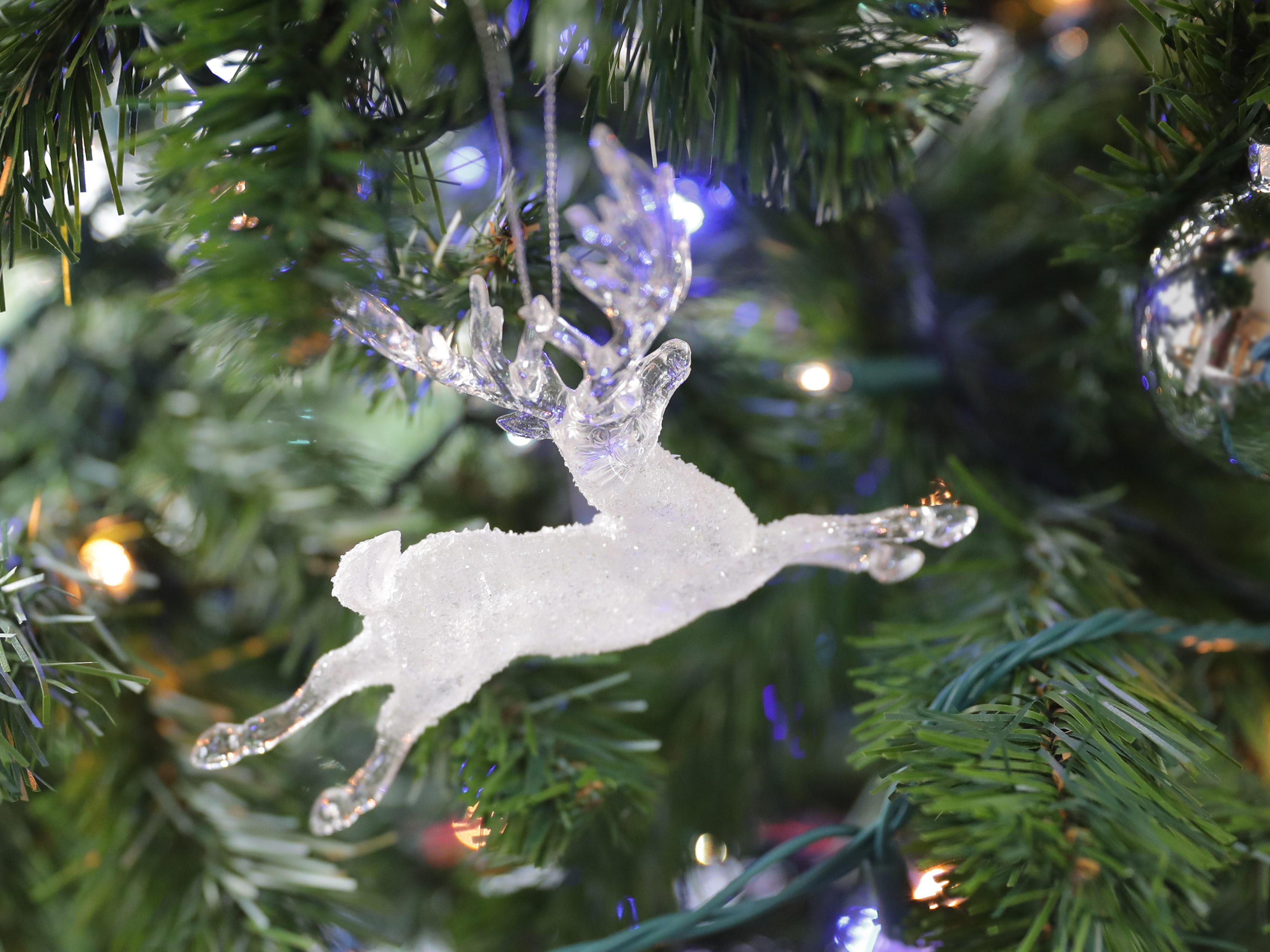 A hunting tree with glass deer ornaments adds cheer to the office.