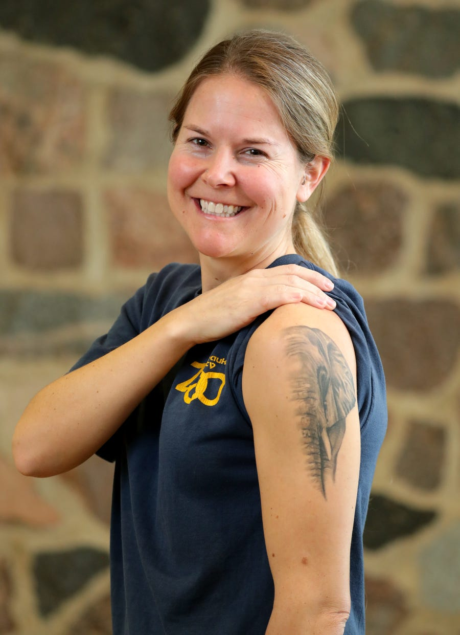 Amy Andree, a Milwaukee County Zoo rover, shows her tattoo of an elephant she got when she worked with elephants at the Kansas City Zoo.