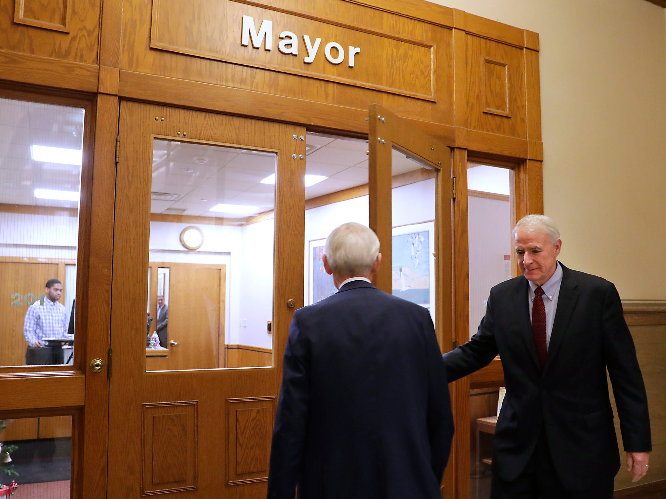Mayor Tom Barrett (right) welcomes Gov.-elect Tony Evers to City Hall on  Tuesday, Dec. 4, 2018.