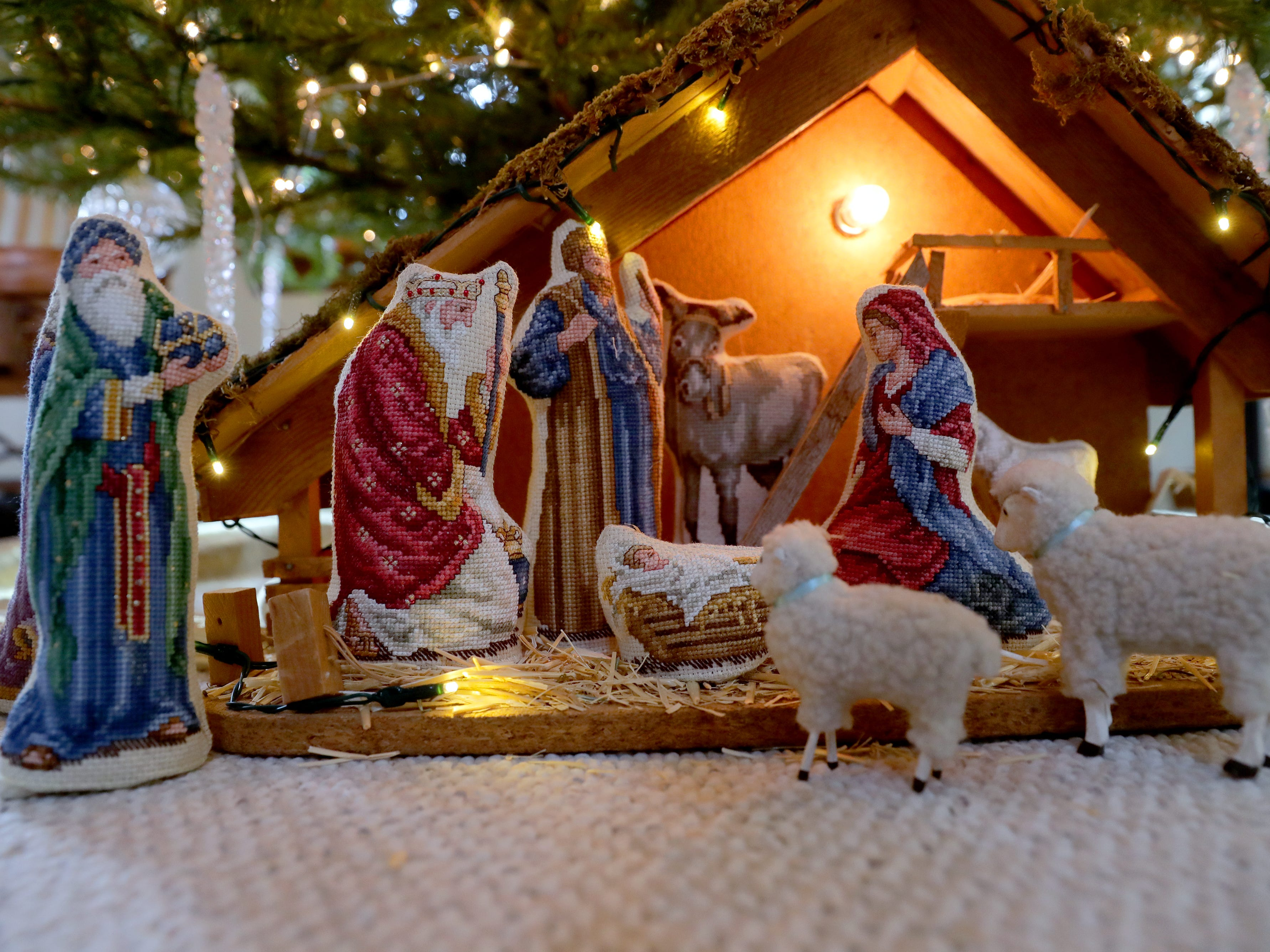 A nativity scene includes cross-stitched figures that Renee Sirny made.