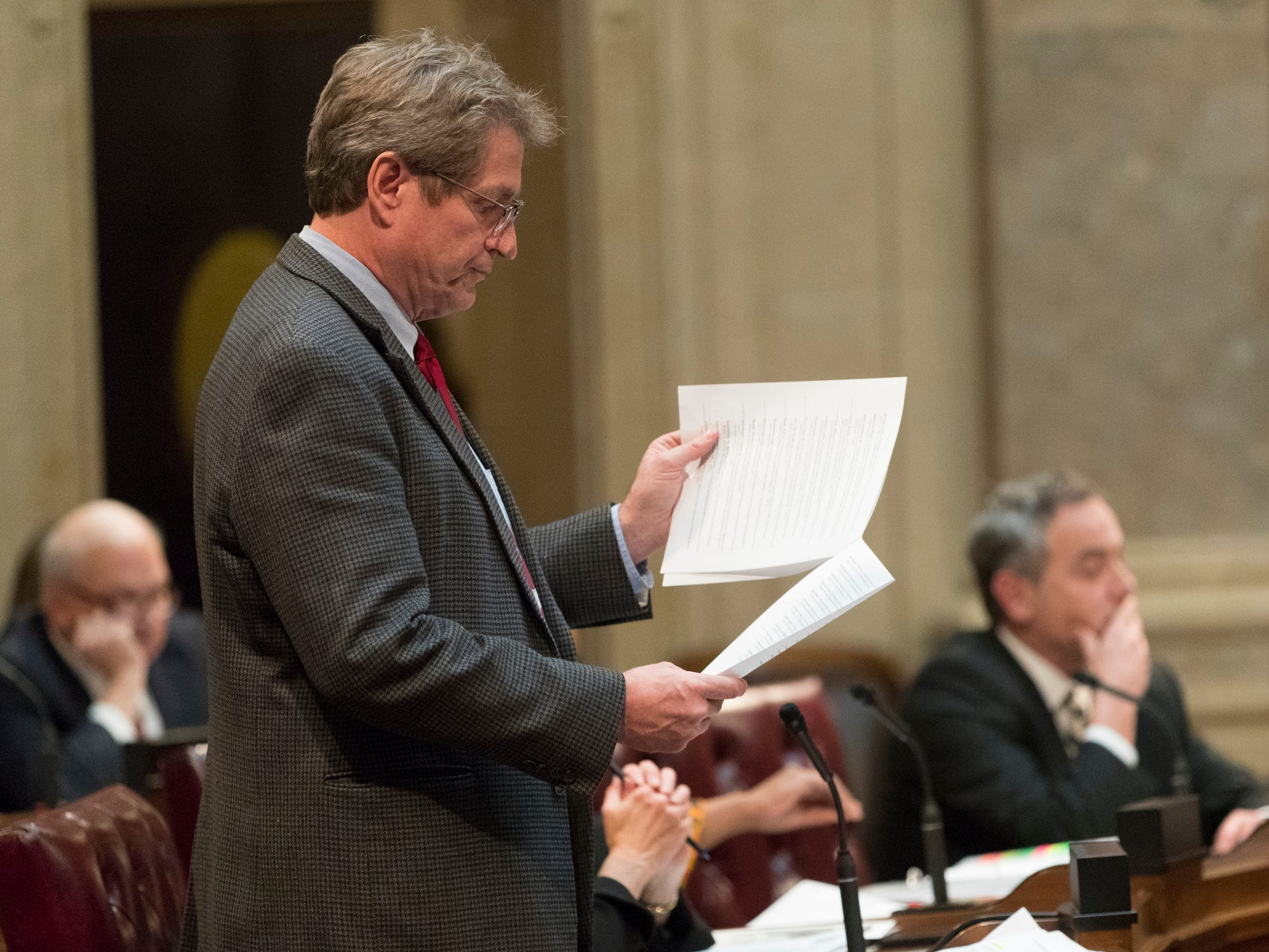 State Sen. Tim Carpenter, D-Milwaukee, questions a list of about 50 appointment referrals submitted to the state Senate at the Capitol in Madison, Wis.