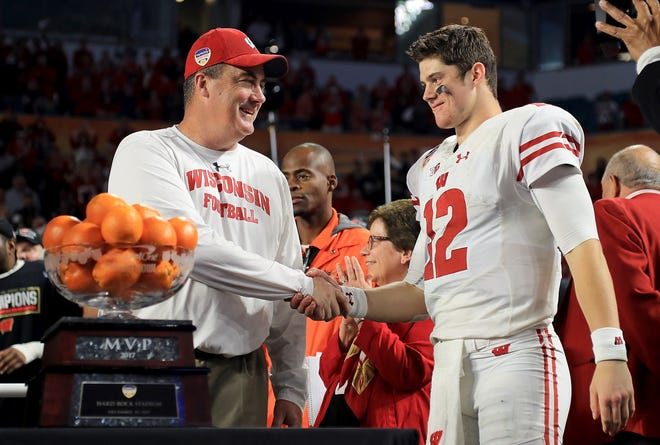 UW quarterback Alex Hornibrook, who completed 23 of 34 passes for 258 yards and four touchdowns last season in the Orange Bowl, is congratulated by coach Paul Chryst after their victory over Miami.
