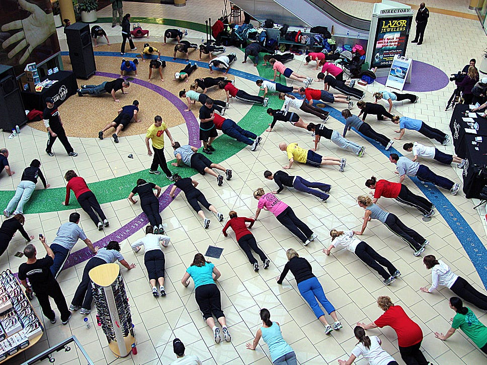 Workout Worldwide trainers and participants working out to set a Guinness World Record and to raise money for the American Heart Association at Grand Avenue Mall in downtown Milwaukee.