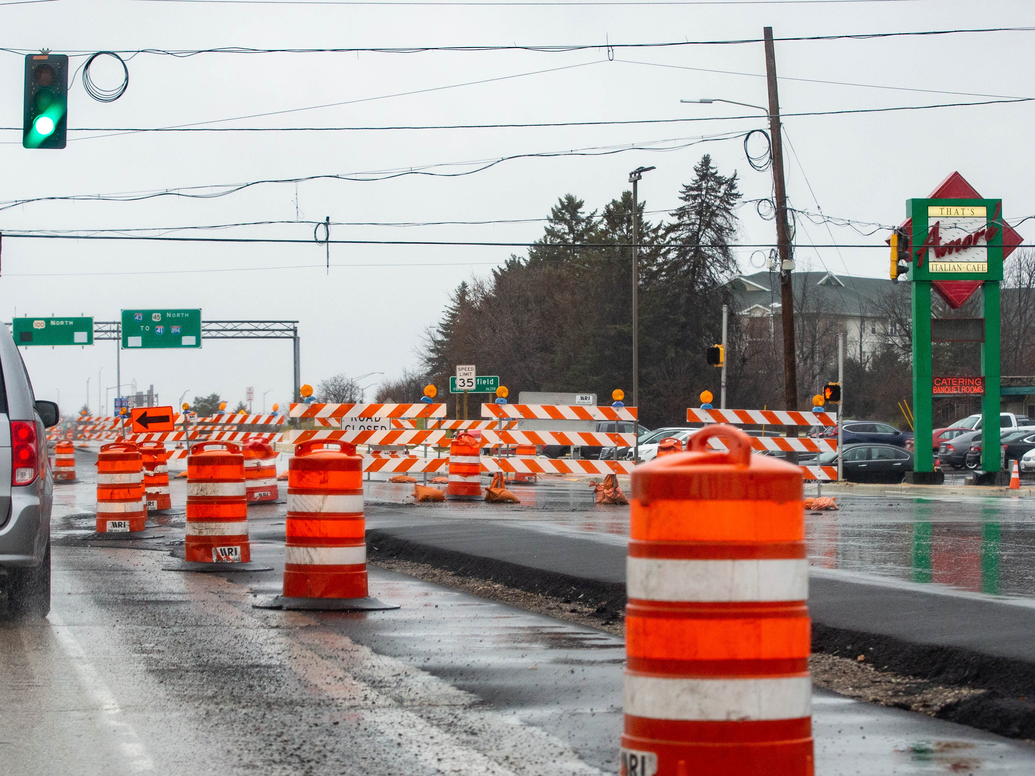 Traffic flows past That's Amore Italian Cafe at South 108th St. and West Edgerton Ave. in Hales Corners on Sunday, Dec. 2, 2018. Construction issues on the northbound lanes (at right) have delayed the project.