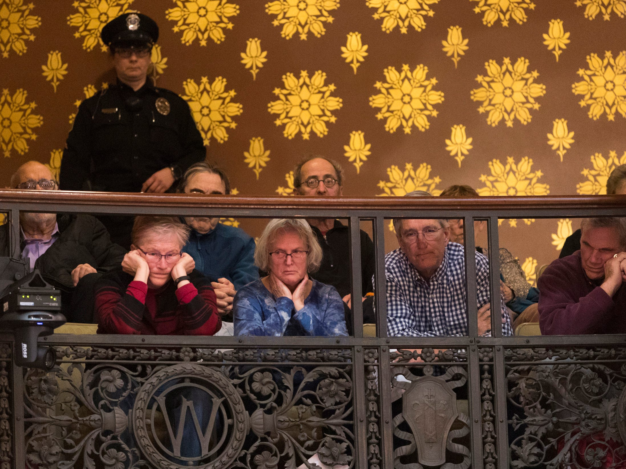 Members of the gallery listen to debate before it was ordered cleared Tuesday.