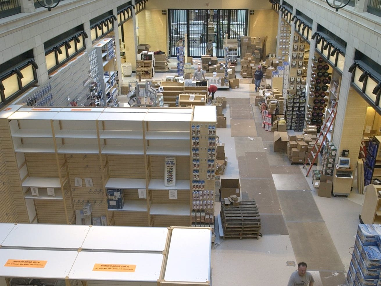 Workers set up shelves and displays for the new Linen n' Things store in the Grand Avenue Mall Wednesday, March 10, 2004.