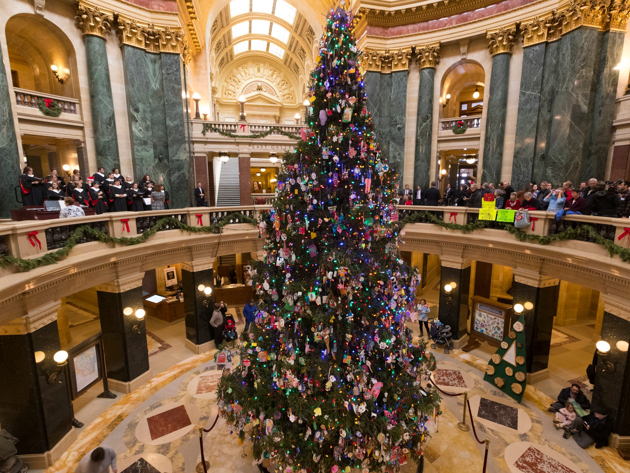 The official Christmas tree is lit at the Capitol in Madison, Wis., Tuesday.