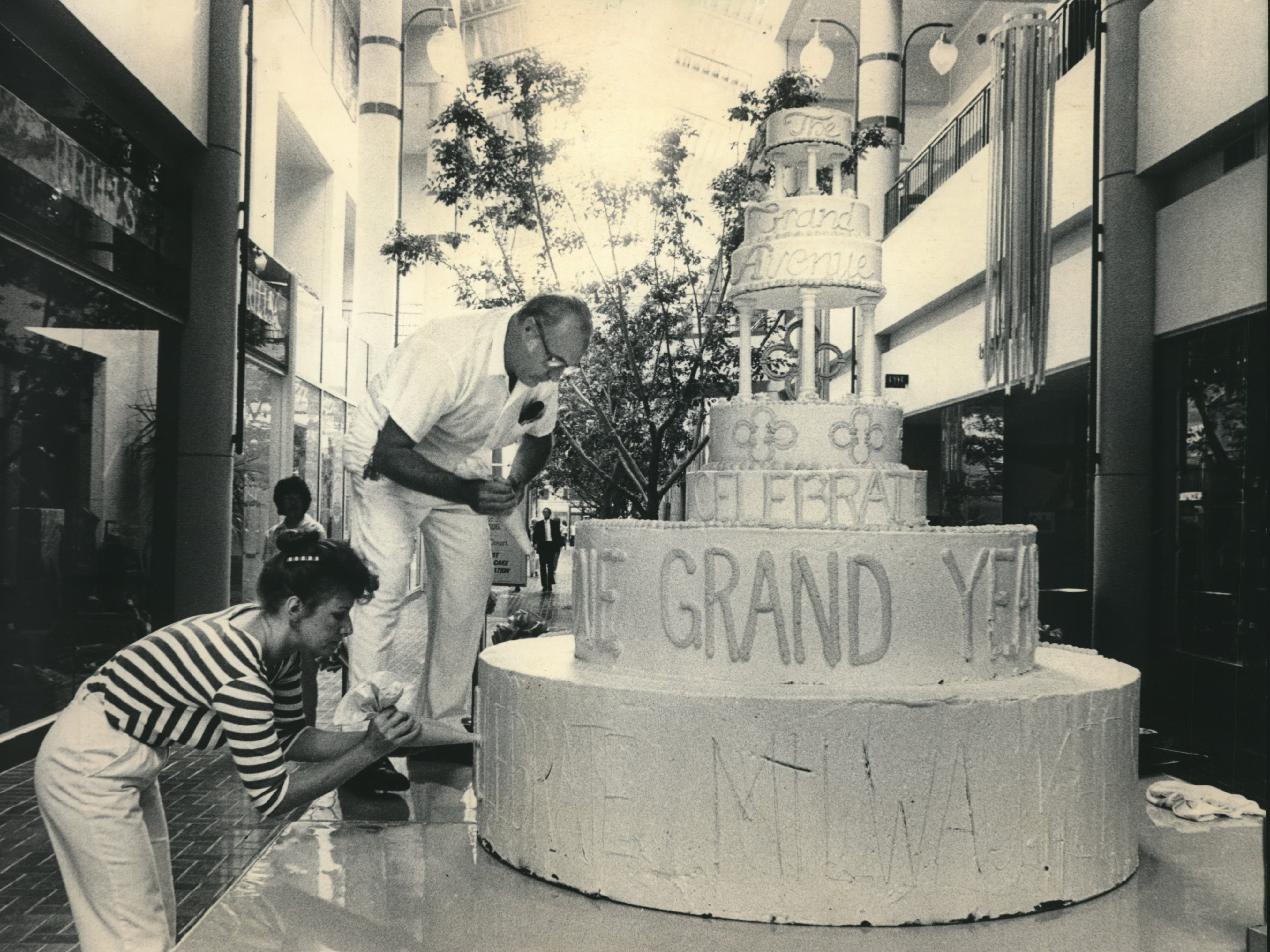 Kurt Haberer and Diane Dentice of the Shorewood Village Bakery prepared a giant birthday cake, getting it ready for a Friday party that was part of the celebration marking the first anniversary of the opening of Milwaukee's Grand Avenue retail center. The celebration,, featuring music and dance performances, runs through Sunday. Grand Avenue Mall in Milwaukee
