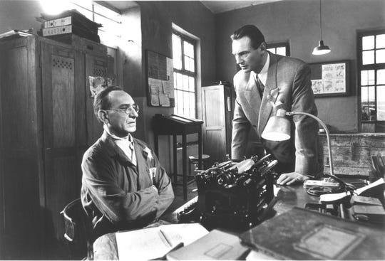 "German industrialist Oskar Schindler (Liam Neeson, right) works with clerk Itzhak Stern (Ben Kingsley) to use his factory to keep Jews out of the Nazi death machine in ""Schindler's List."""