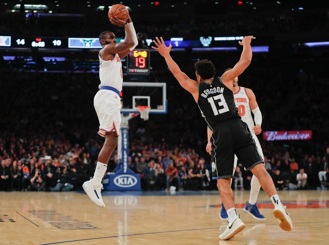 New York Knicks guard Tim Hardaway Jr. (3) puts up a shot against Milwaukee Bucks guard Malcolm Brogdon (13) during the first quarter of an NBA basketball game, Saturday, Dec. 1, 2018, in New York.(AP Photo/Julie Jacobson) ORG XMIT: NYJJ