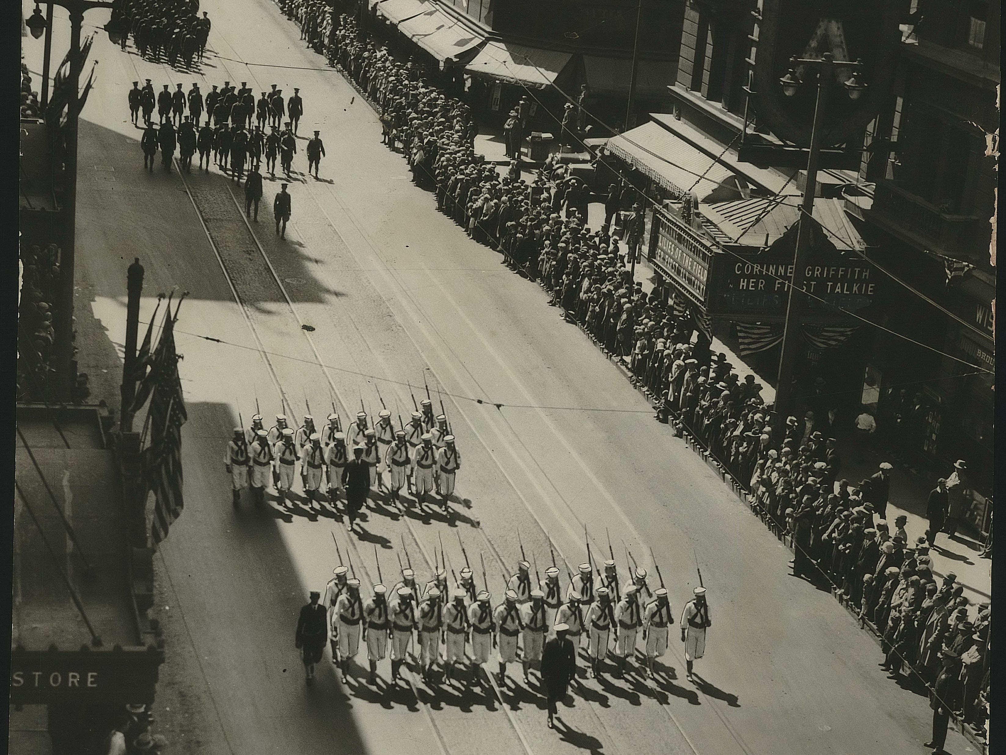 1930: Wisconsin Avenue looked like the grand avenue of war days as soldiers, sailors, veterans and rookies marched or rode down the street between thousands of spectators massed on both curbs. It was the annual Memorial days parade. The picture was taken from the Matthews building, looking west up the avenue from Third Street.
