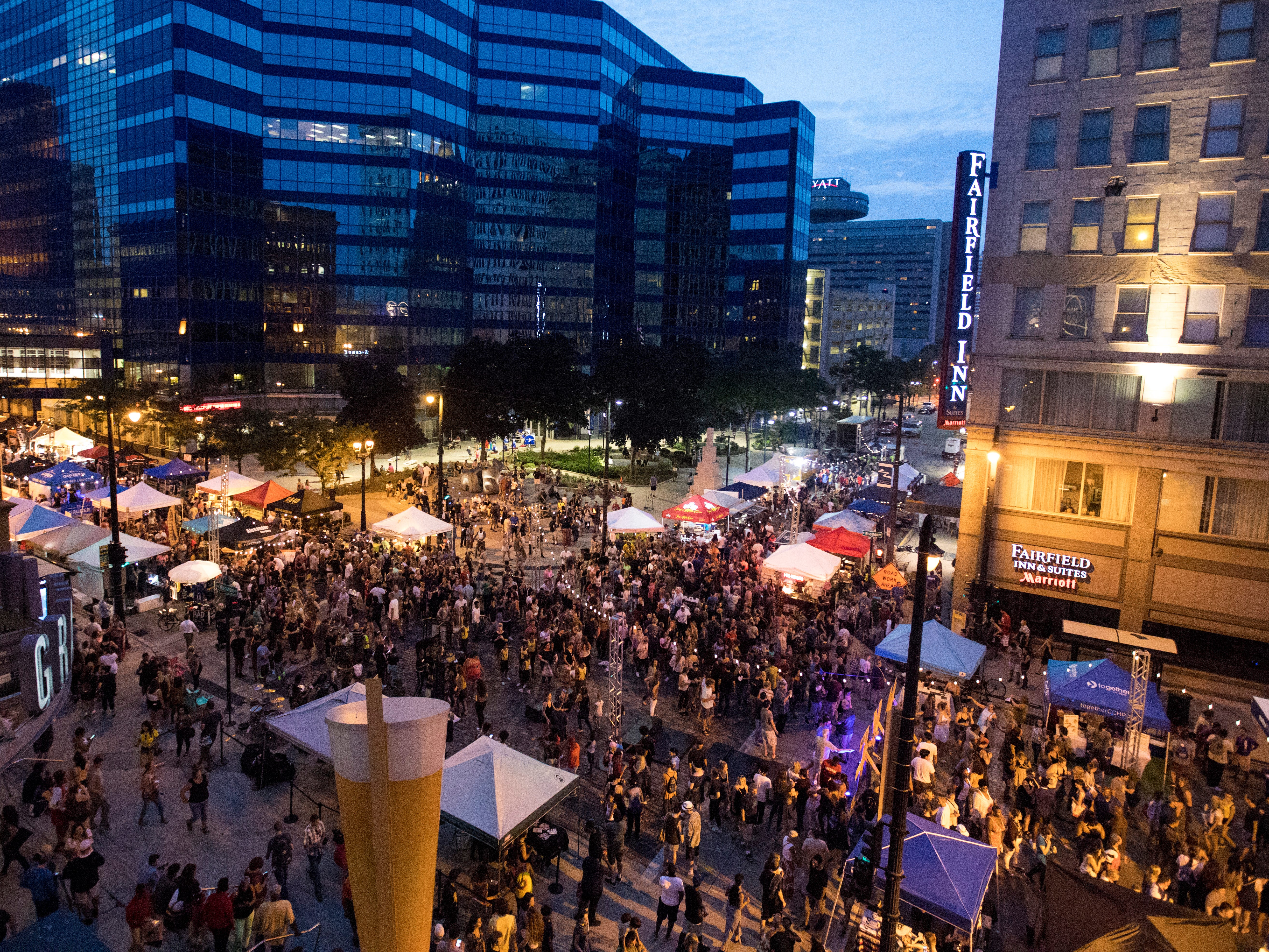 ---Night Market includes a VIP section that is on the third floor balcony at the Grand Avenue mall. The balcony over looks the main central area of the Night Market as people come to enjoy the music, food and vendors for the nights event. ---Photo by Tyger Williams / Milwaukee Journal Sentinel