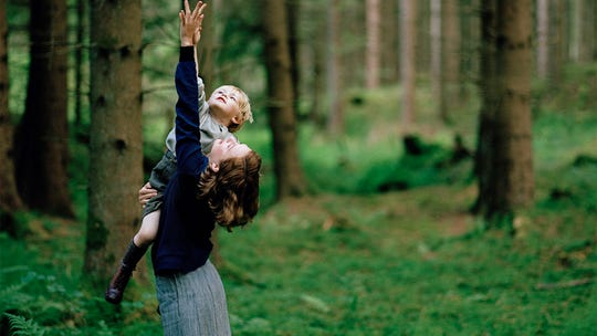 "Astrid Lindgren (Alba August), the woman who would later write the Pippi Longstocking stories, reconnects with her young son (Marius Damslev) in ""Becoming Astrid."""
