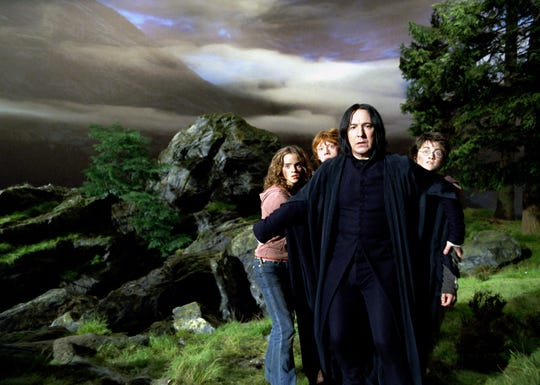 "Professor Snape (Alan Rickman, center) shielfds Hermione (Emma Watson, from left), Ron (Rupert Grint) and Harry (Daniel Radcliffe) in ""Harry Potter and the Prisoner of Azkaban."""