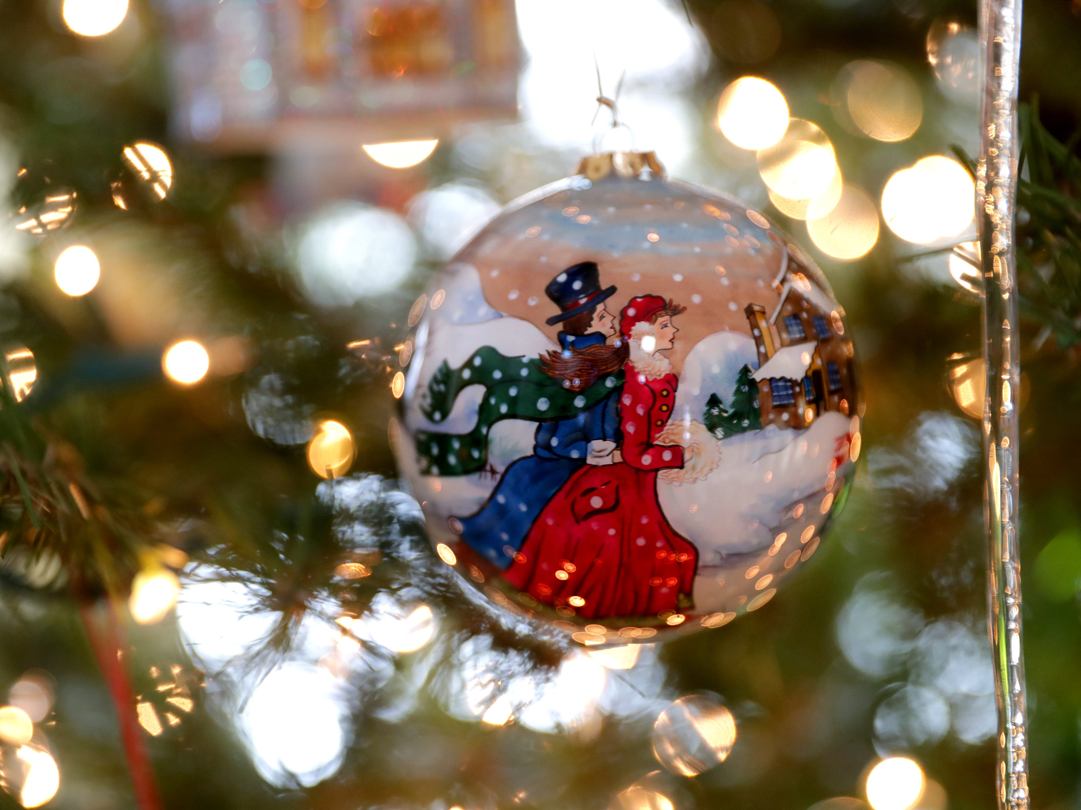 This handpainted ornament hanging on the 10-foot artificial tree in their living room came from Mackinac Island. It is one of Renee Sirny's favorites.