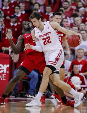 Wisconsin's Ethan Happ drives against Rutgers' Eugene Omoruyi during the first half Monday night.