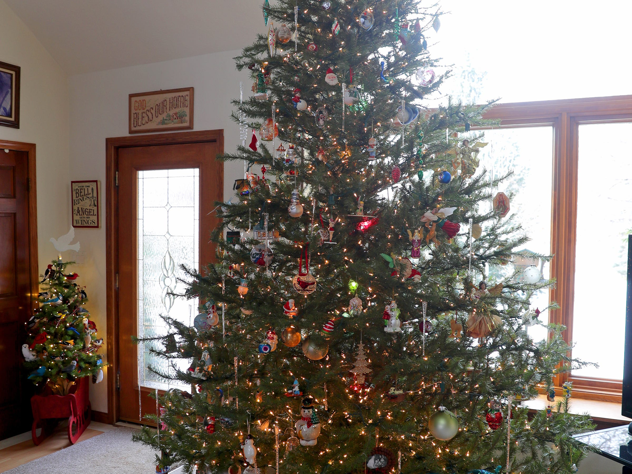 The largest of the trees is this 10-foot artificial tree in the living room. It's the one that gets all the sentimental ornaments.