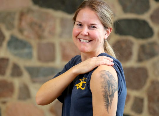 Amy Andree a Milwaukee County Zoo rover shows her tattoo of an elephant she got when she worked with elephants at the Kansas City Zoo.  Several Milwaukee County Zoo zookeepers have animal tattoos that relate to their particular job at the zoo.  Thursday, November 29, 2018. -  Photo by Mike De Sisti / Milwaukee Journal Sentinel