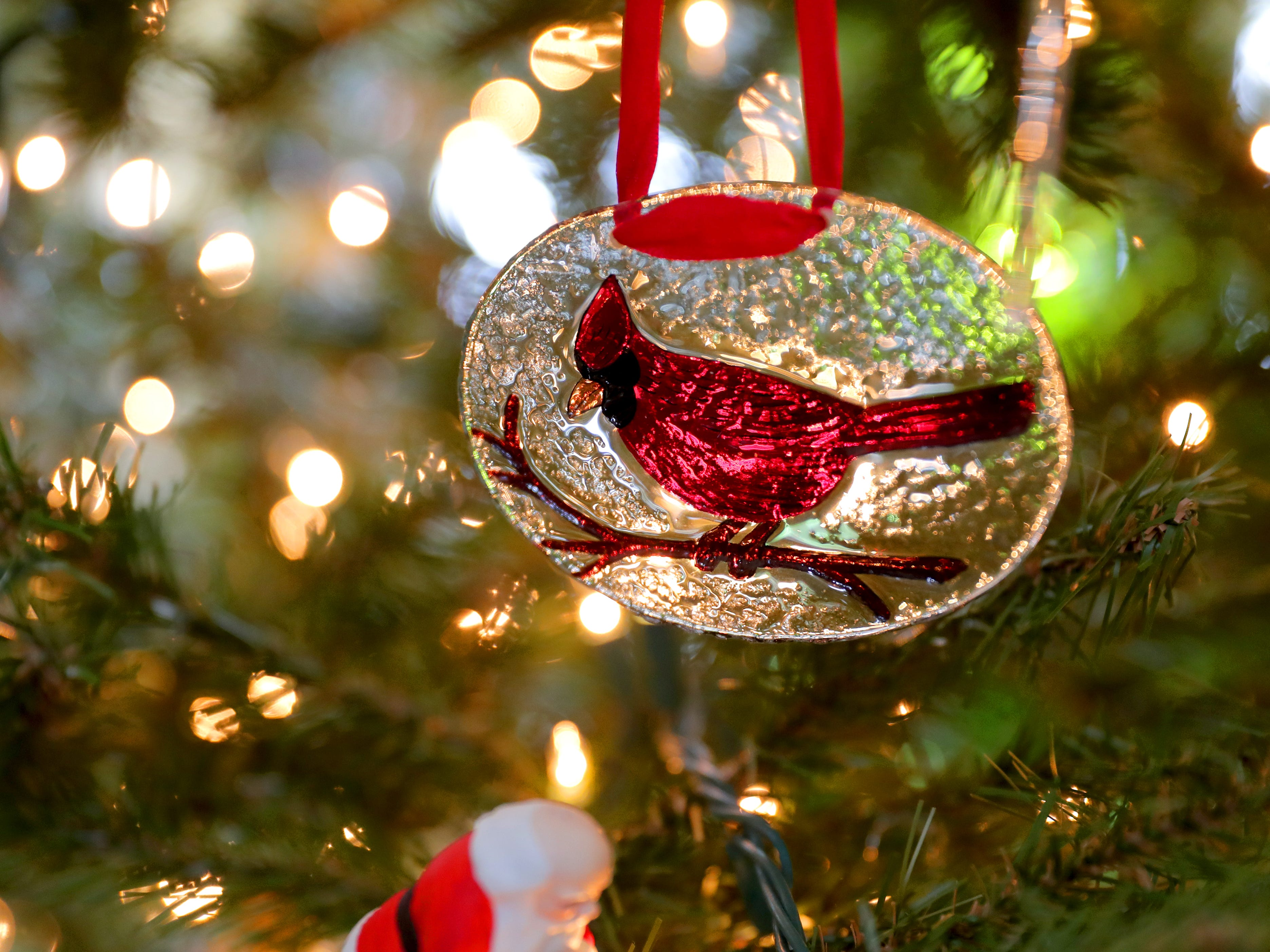 A cardinal ornament hanging on their 10-foot artificial tree in their family room is one of Renee Sirny's favorites, given to her by a friend at work.