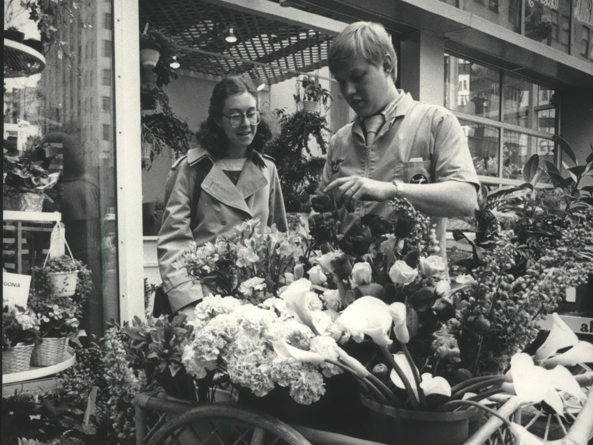 Dale Preuss helped Dana Longstreth build a bouquet at Alan Preuss Florists in the Grand Avenue.