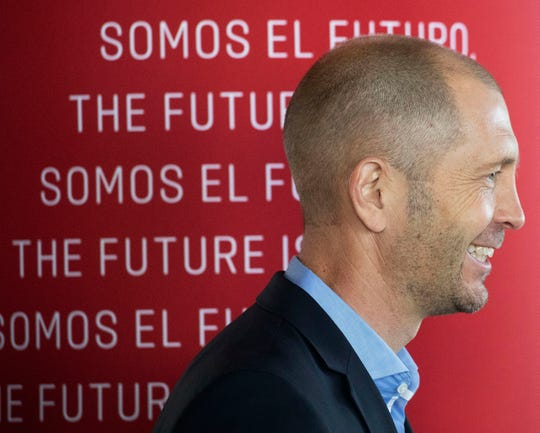 Gregg Berhalter, the new head coach of the U.S. men's national soccer team, speak at a news conference, Tuesday, Dec. 4, 2018, in New York. (AP Photo/Mark Lennihan)