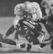 Arrid Gregory, whose 1,337 rushing yards in 1996 remain a Troy school record, is tackled by Alabama State's Al Pogue. Pogue is now an assistant coach at Troy.