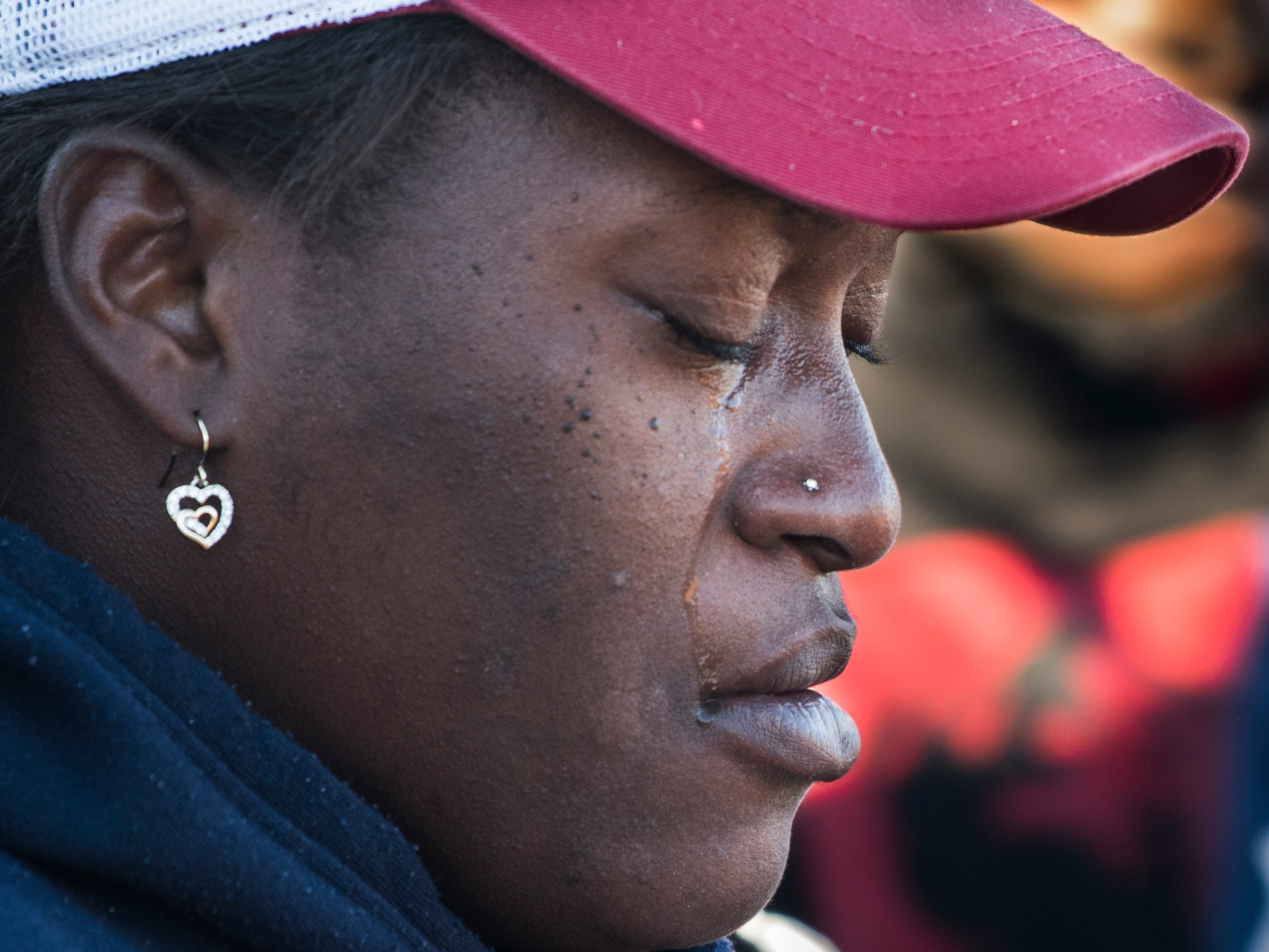 Tiffany Williams sheds a tear during a vigil for her daughter, Keiauna Williams, across from Carver High School in Montgomery, Ala., on Tuesday, Dec. 4, 2018. Williams was died after being hit by a car Saturday night.