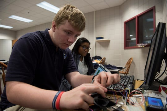 James Bender, freshman, left, and Mai Ellington, sophomore, work on their  Raspberry Pi project at Montgomery Catholic High School in Montgomery, Ala., on Monday, Dec. 3, 2018.