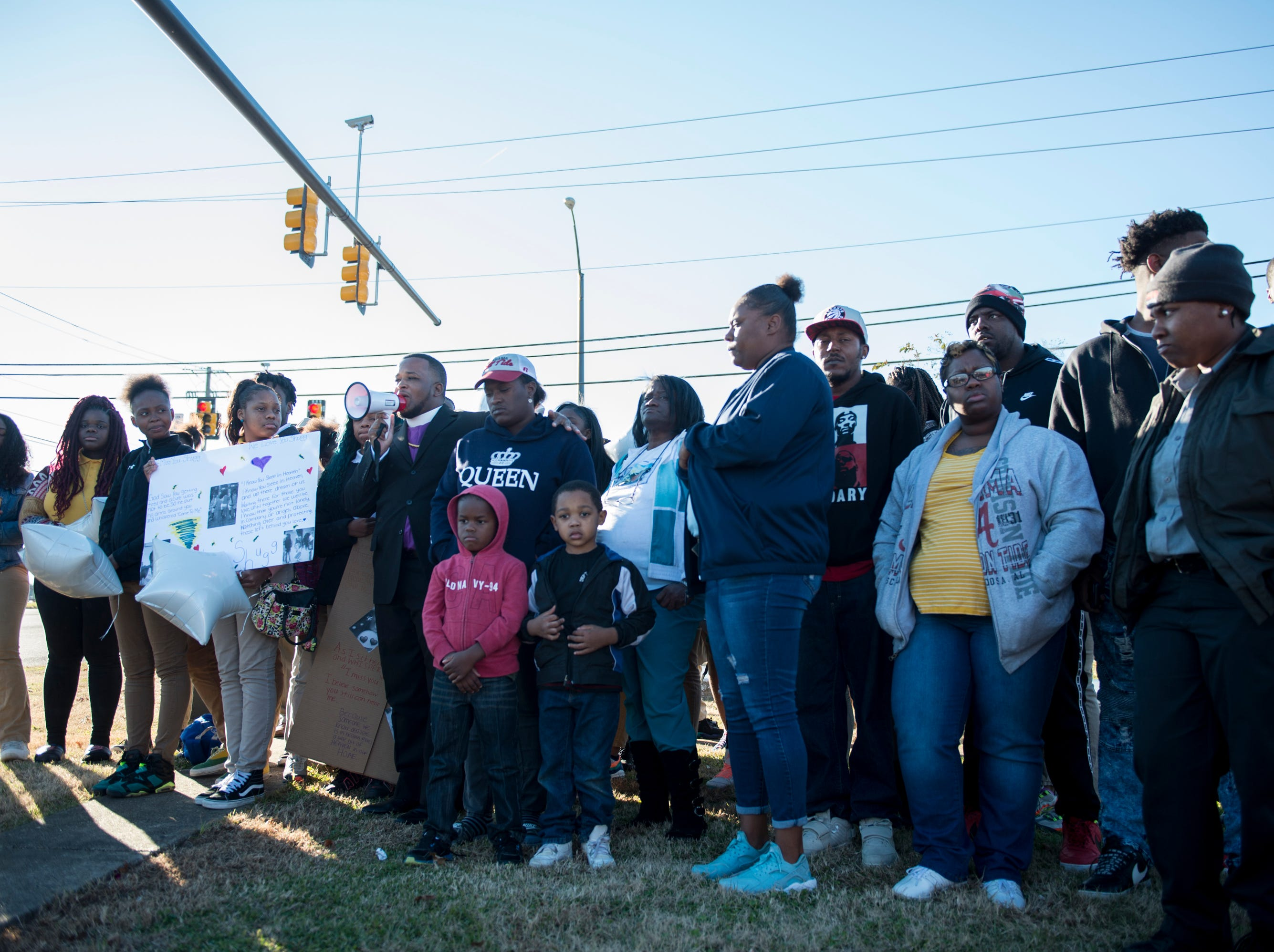 Ja'Mel Brown leads a vigil for Keiauna Williams across from Carver High School in Montgomery, Ala., on Tuesday, Dec. 4, 2018. Williams was died after being hit by a car Saturday night.