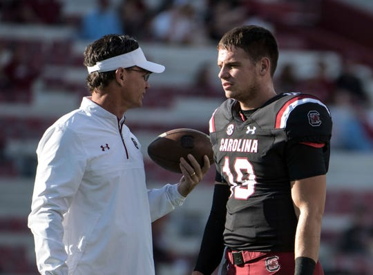 South Carolina quarterback Jake Bentley (19) and his father, running backs coach Bobby Bentley.