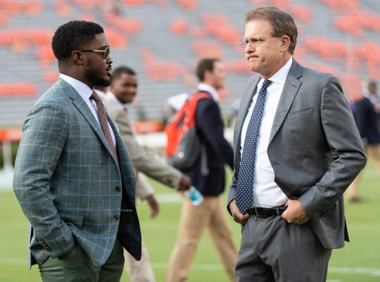 Auburn wide receivers coach Kodi Burns (left) with Auburn head coach Gus Malzahn (right).