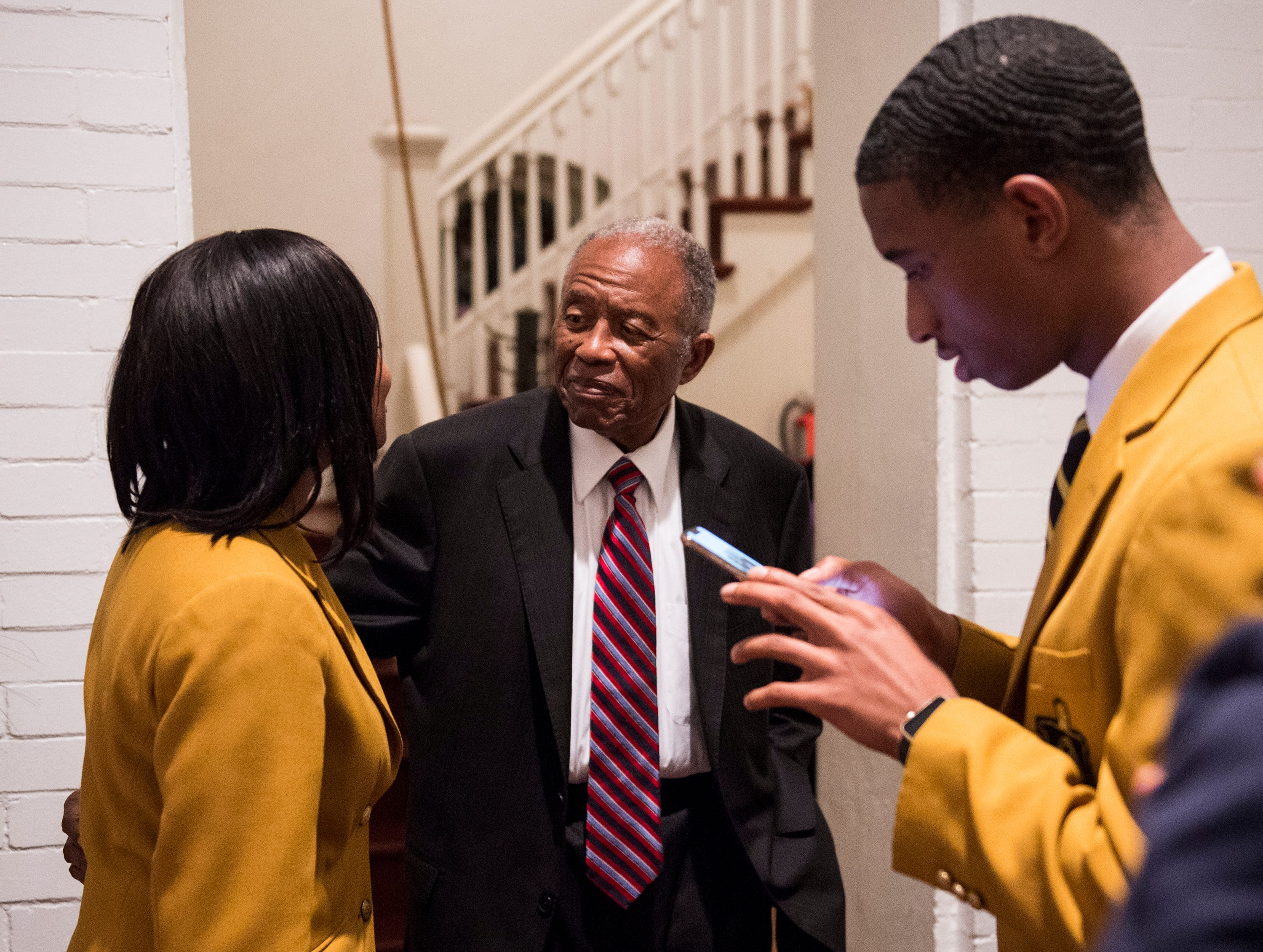 Fred Gray takes pictures with Alabama State University students during 63rd anniversary of the Montgomery bus boycott ceremony at First Baptist Church in Montgomery, Ala., on Monday, Dec. 3, 2018.