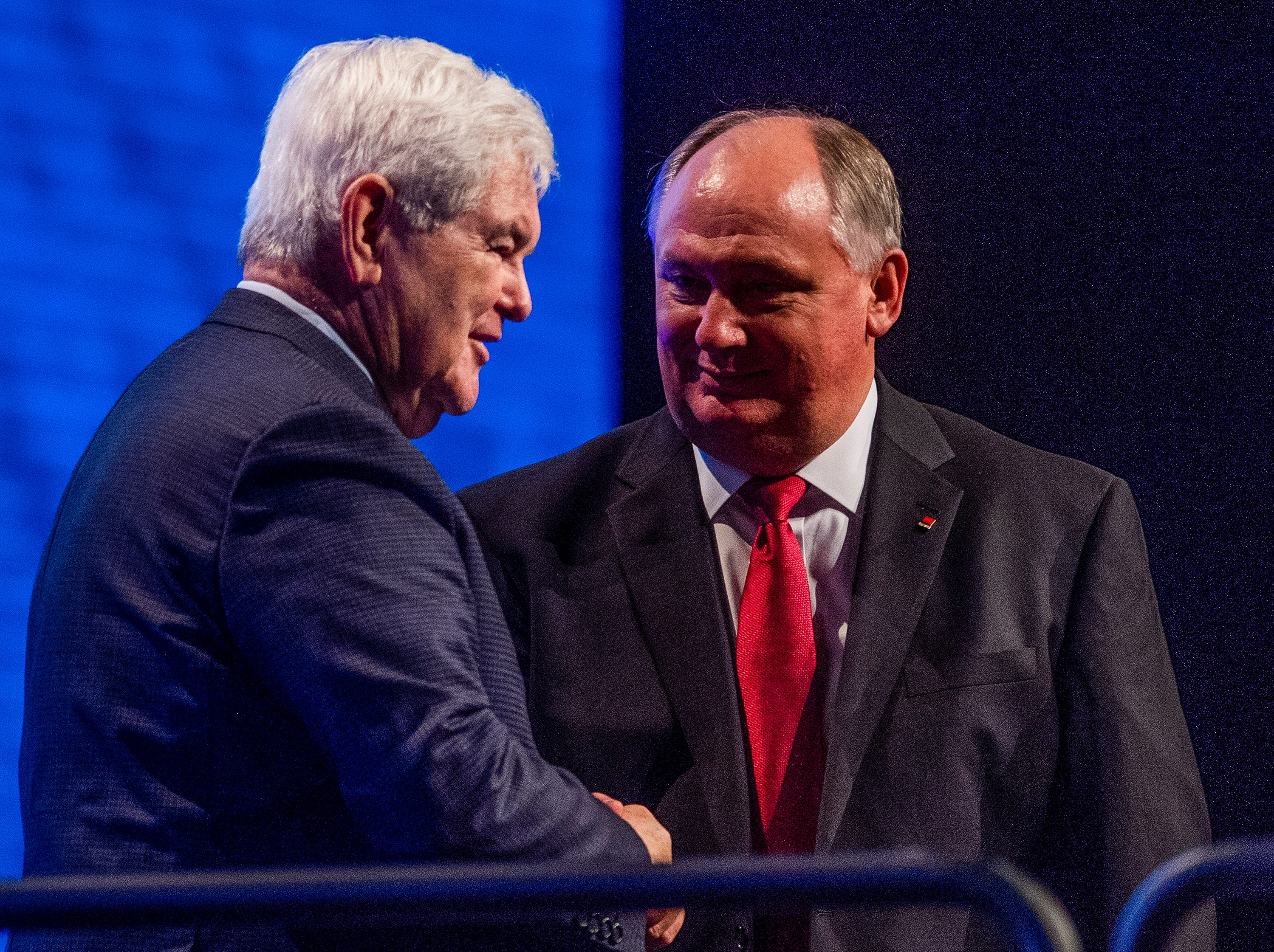 Former Speaker of the House Newt Gingrich is greeted by Alabama Farmers Federation President during the Alfa Farmers Annual Meeting at the Convention Center in Montgomery, Ala., on Monday evening December 3, 2018.