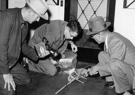 Montgomery law enforcement officers disarm a bomb on Jan. 28, 1957, one of several planted in the wake of the Montgomery Bus boycott.
