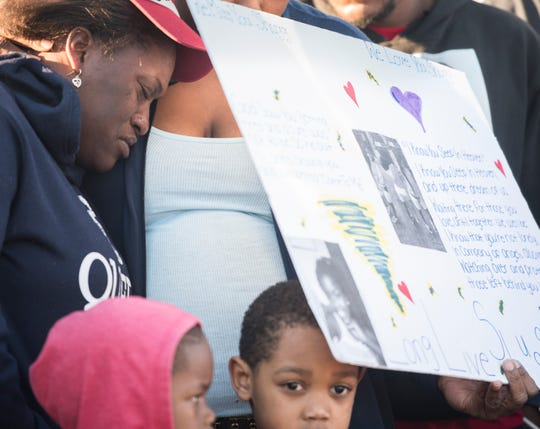Tiffany Williams is comforted during a vigil for her daugter, Keiauna Williams, across from Carver High School in Montgomery, Ala., on Tuesday, Dec. 4, 2018. Keiauna Williams was died after being hit by a car Saturday night.