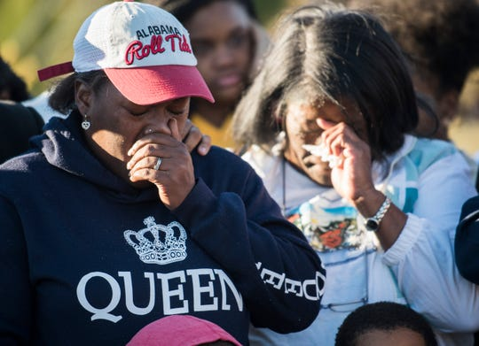 Mother Tiffany Williams, left, and Grandma Mary Williams become emotional during a vigil for Keiauna Williams across from Carver High School in Montgomery, Ala., on Tuesday, Dec. 4, 2018. Keiauna Williams was died after being hit by a car Saturday night.