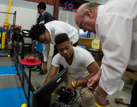 Tech teacher Steve Ballard works with students Damian Wilkerson, from left, Cameron Pearson, Jordan Robinson and Jayden Sloan on their Raspberry Pi projects at Brewbaker High School in Montgomery, Ala., on Monday, Dec. 3, 2018.