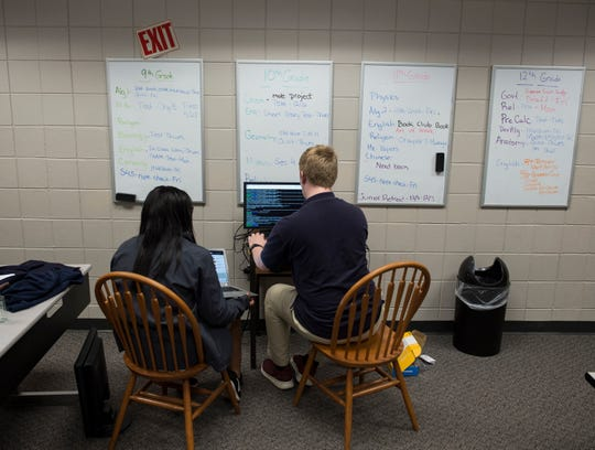 Mai Ellington, sophomore and James Bender, freshman, work on code for their Raspberry Pi project at Montgomery Catholic High School in Montgomery, Ala., on Monday, Dec. 3, 2018.